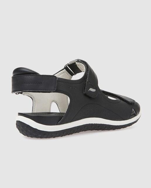 Geox Sandalias planas de mujer Geox de color negro con velcros. Modelo exclusivo online.