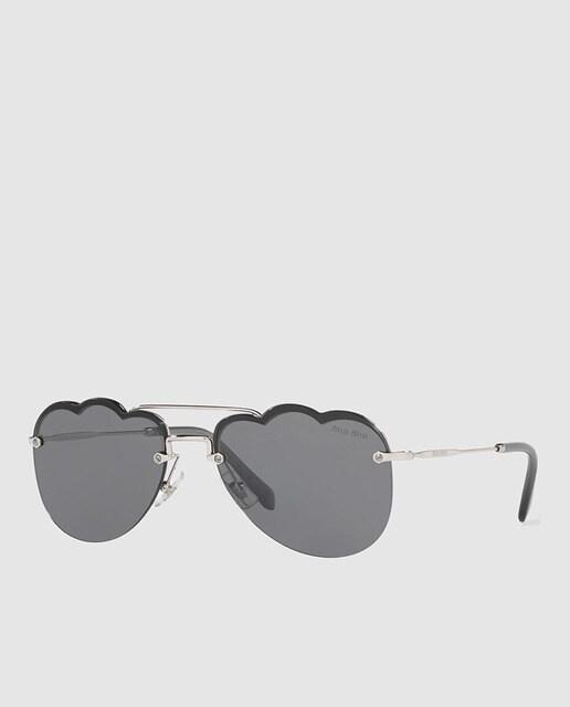 5e436ac28b Gafas de sol de mujer Miu Miu de metal plateada con montura al aire y lentes
